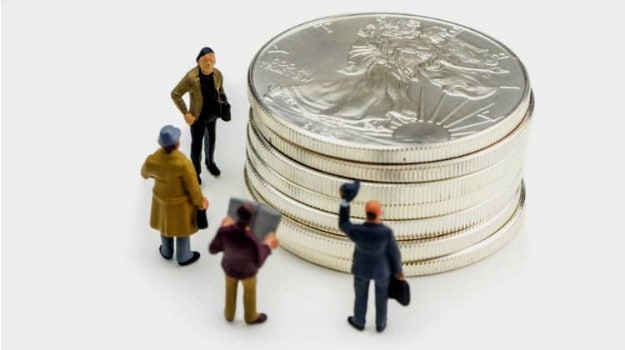 miniature people and coins | Precious Metals Market: A Complete Guide on Investing in Precious Metals | Inside Your IRA