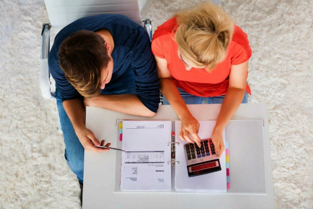 couple calculating expenses | What is a SEP-IRA? | A Guide to Your Retirement Inside Your IRA | sep ira rules