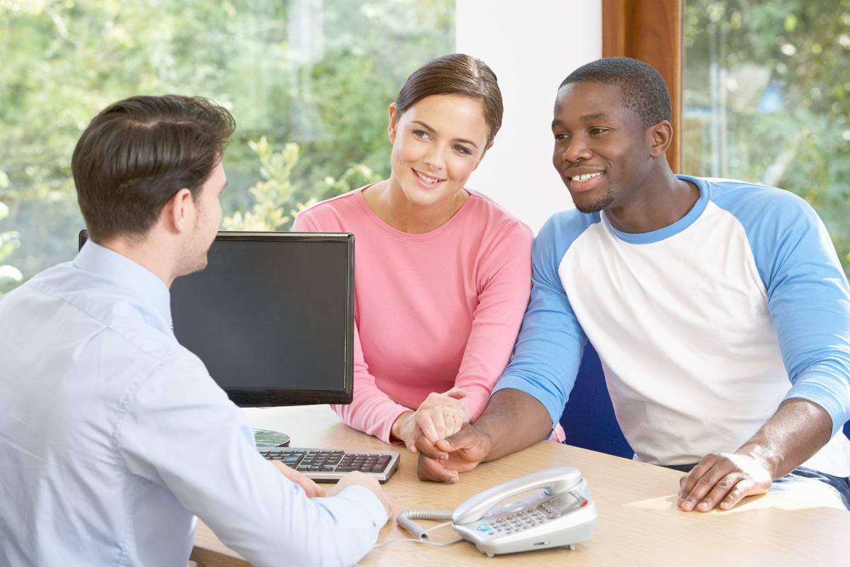 couple talking to financial advisor   Spousal IRA Contribution Limits   Inside Your IRA   spousal ira rules