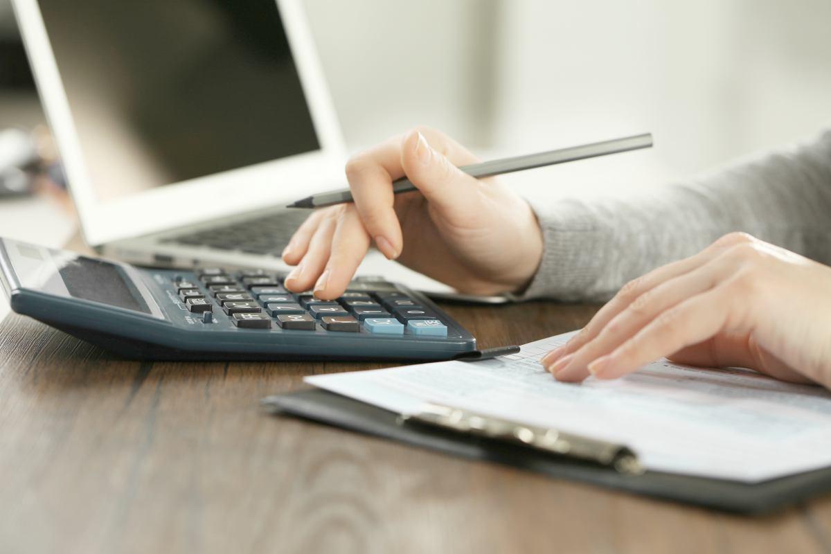 female using calculator   Spousal IRA Contribution Limits   Inside Your IRA   spousal ira contribution limits