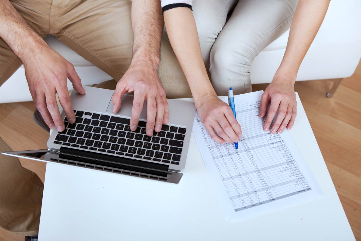 couple doing family finances   Spousal IRA Contribution Limits   Inside Your IRA   spousal ira contribution