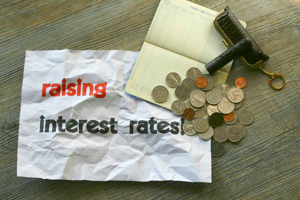 coins and paper   Roth IRA Interest Rates: How Does Your Money Grow?   Roth IRA interest rates   td ameritrade