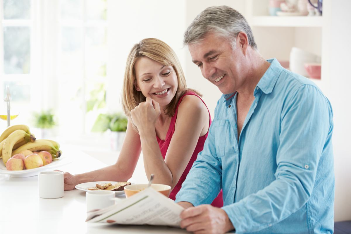 middleaged couple having breakfast | What Are Traditional IRA Contribution Limits? | traditional IRA contribution limits | catch-up contribution