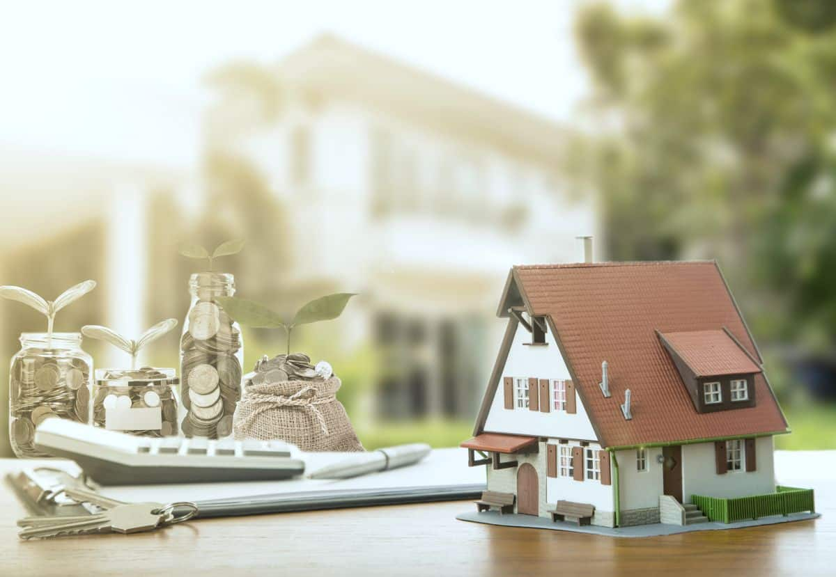 miniature house and coins   How To Start Investing In Real Estate Inside Your IRA   how to start investing in real estate   how to start investing in real estate