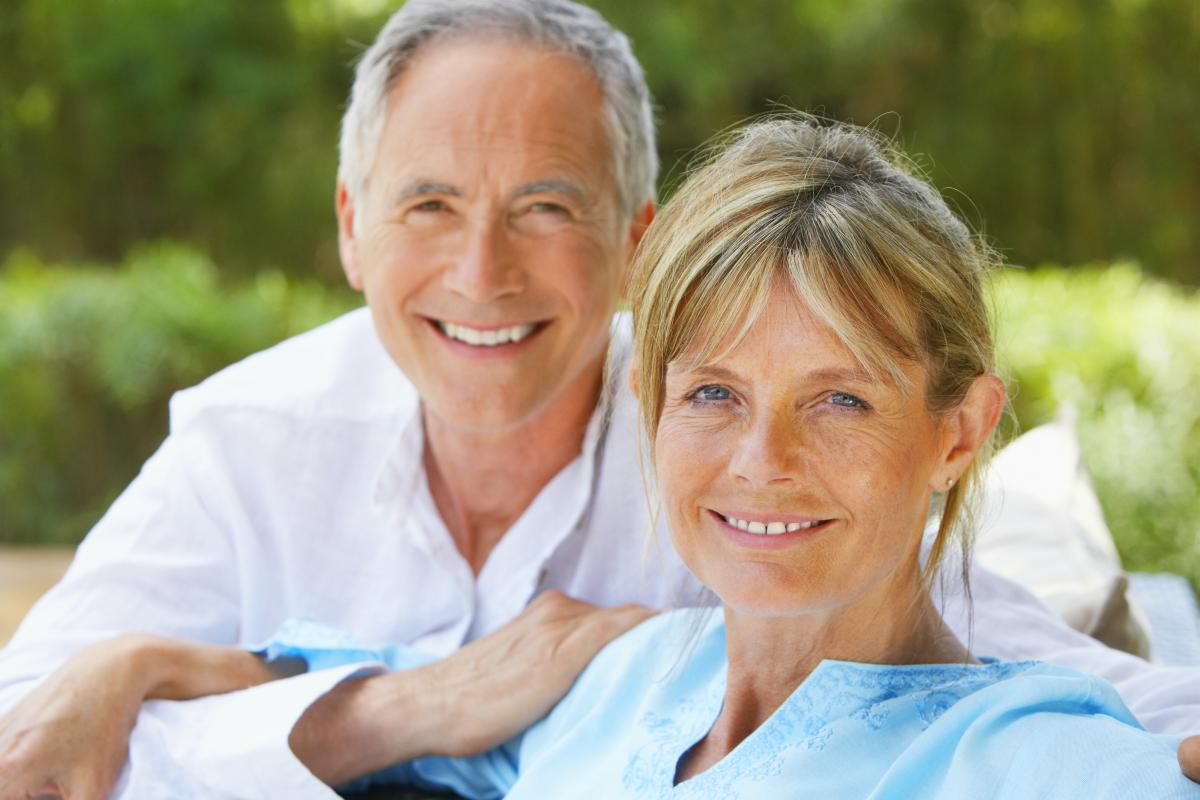 senior couple smiling | IRA Definition | Easy To Understand Answers To Your IRA Questions | IRA definition | Roth IRA