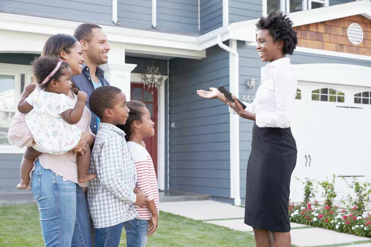 real estate agent showing the house to family   How To Start Investing In Real Estate Inside Your IRA   how to start investing in real estate   biggerpockets podcast