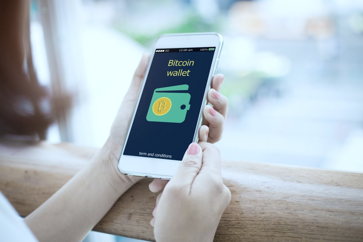 person using bitcoin app | What Is Bitcoin And How Can I Invest It In My IRA? | should you invest in bitcoin