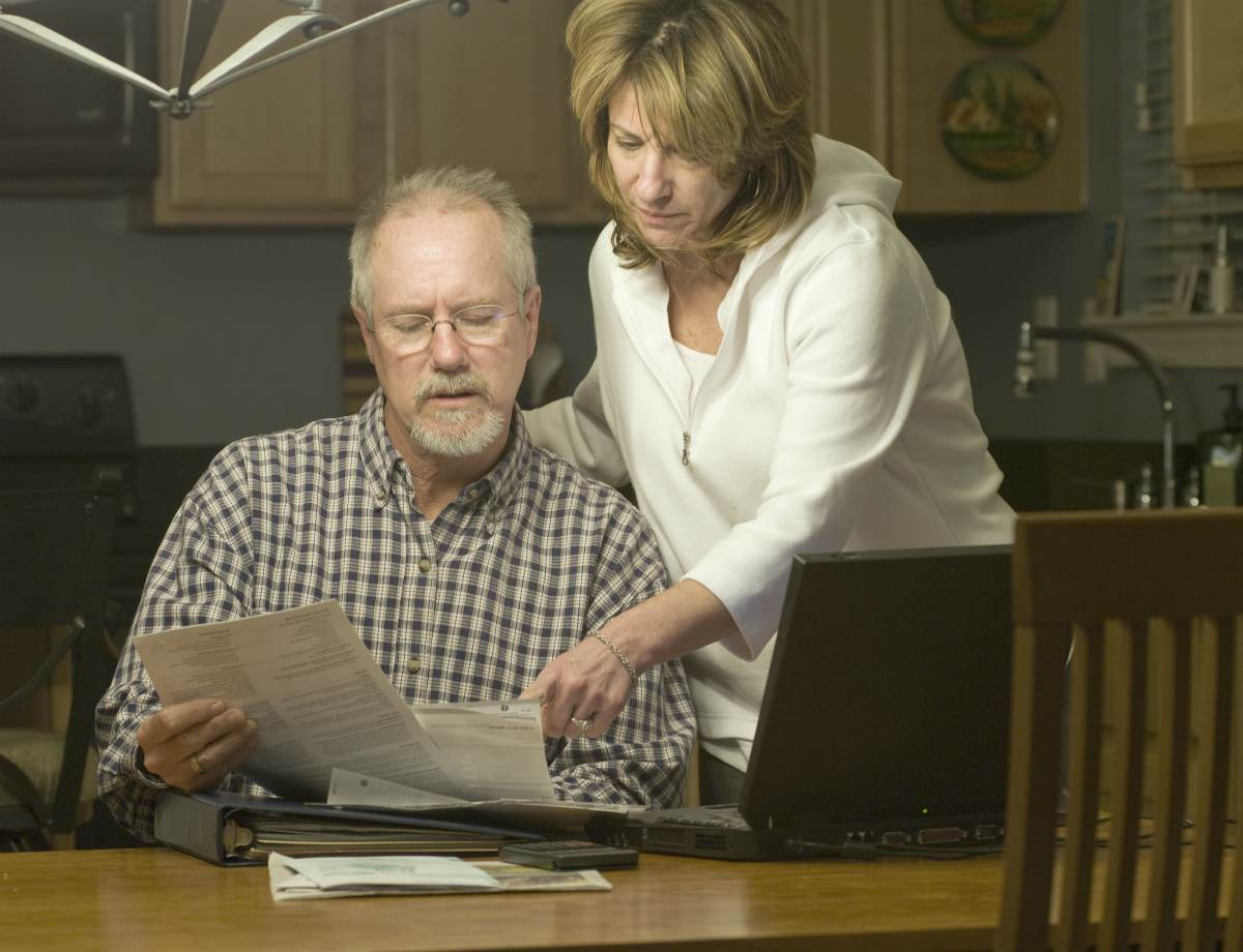 elder couple reading financial statements | What Is A Roth IRA? What You Need To Know | Inside Your IRA | what is a Roth IRA | adjusted gross