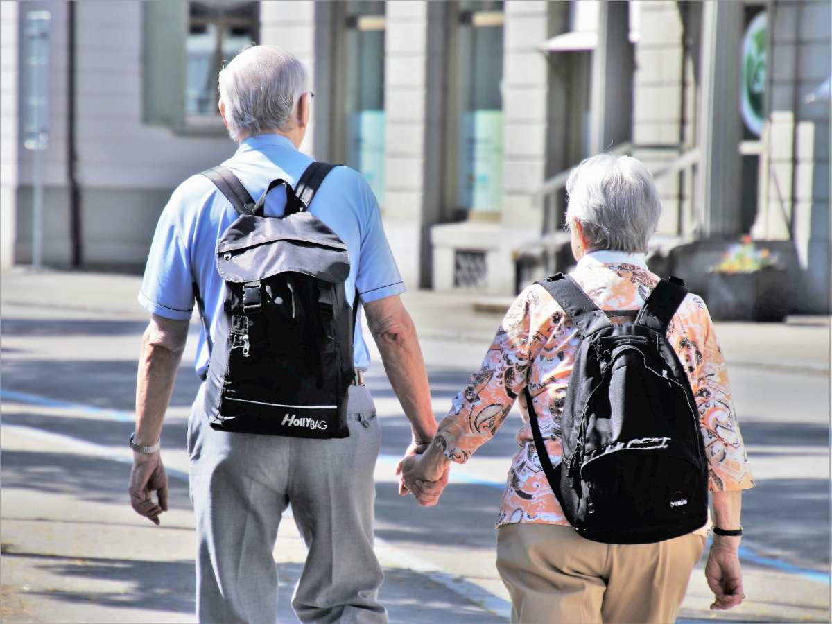 senior couple holding hands | What Is An Inherited IRA? | Inside Your IRA | what is an inherited IRA | inherited ira irs