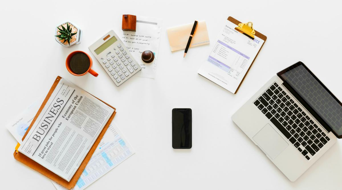 white calculator beside brown ceramic mug | What Is A Mutual Fund? Everything You Need To Know | Inside Your IRA | what is a mutual fund | best mutual fund companies