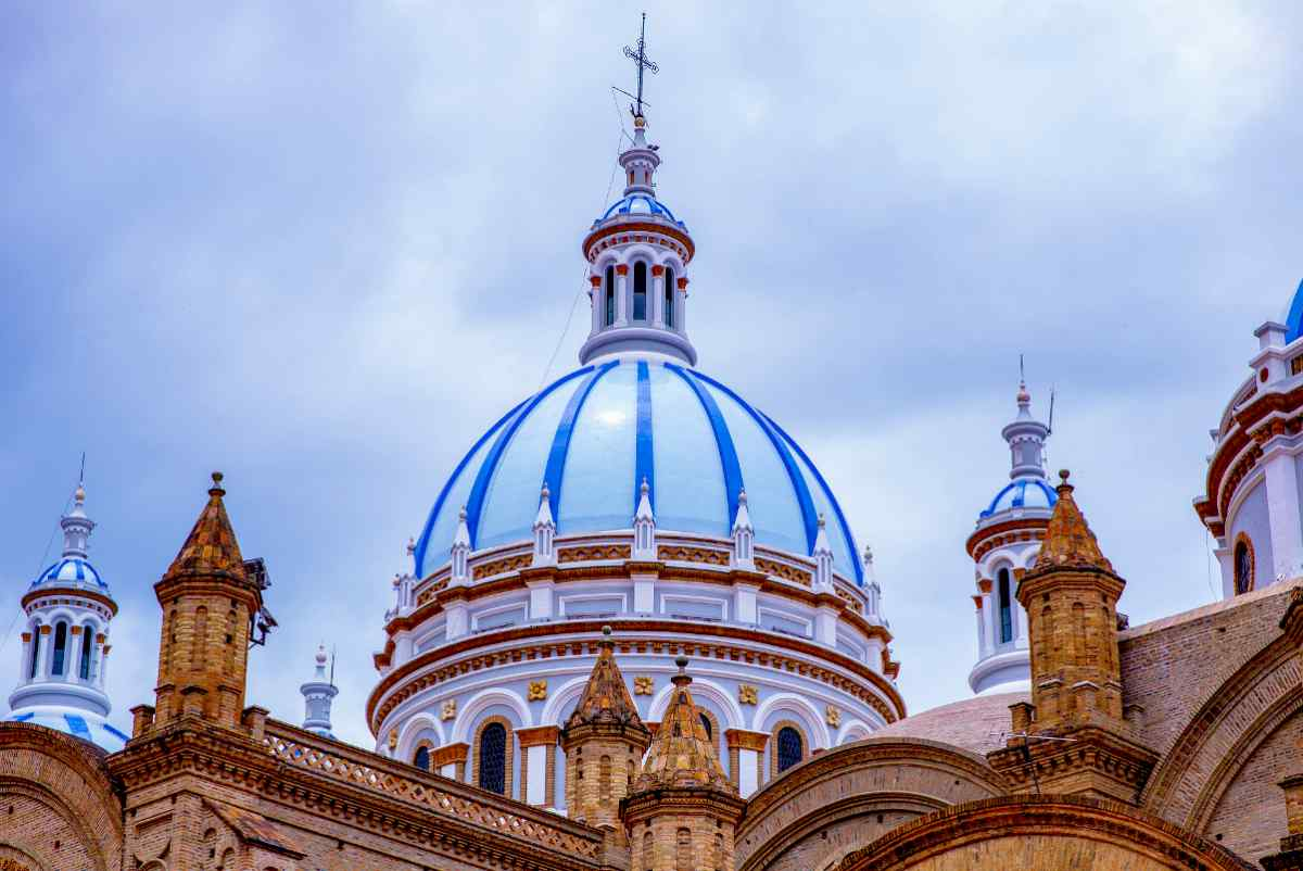 cathedral dome under dark clouds | Ecuador | best retirement countries