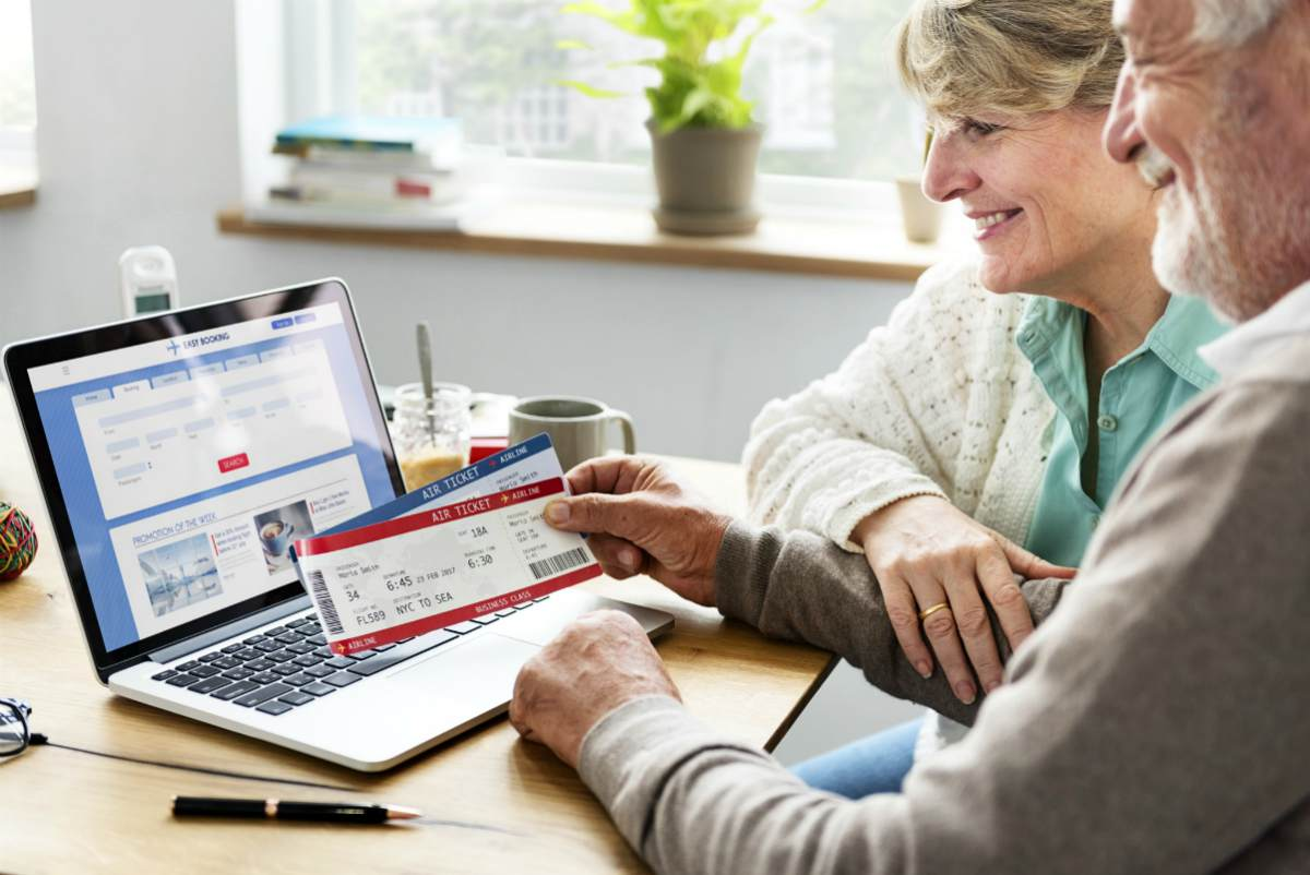 elderly couple booking flight   How To Afford Travel In Your 70s   Life After Retirement   Inside Your IRA   retirement activities list