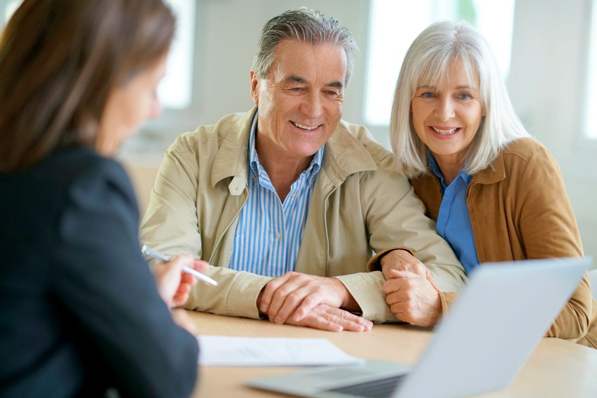 senior couple consulting with financial adviser   What Is Investment Banking? And Other Investment Terms, Defined   Inside Your IRA   investment risk