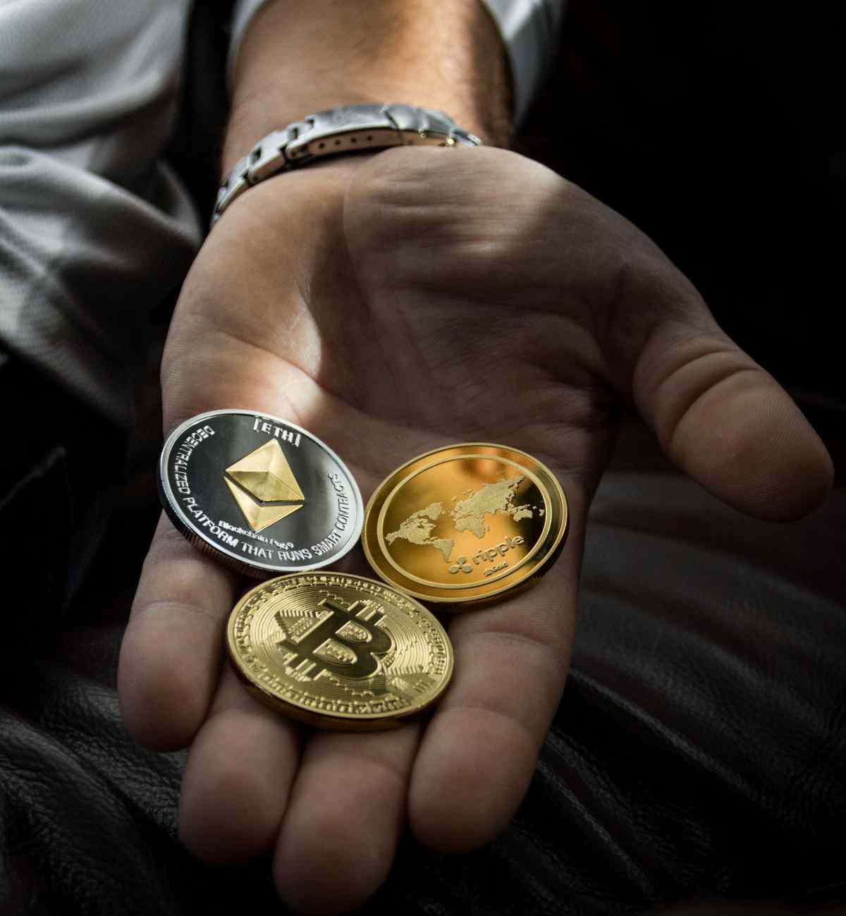 Hand holding Cryptocurrencies   Is Bitcoin A Good Investment? Volatility Factors To Consider   Inside Your IRA   cryptocurrency investing