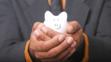 Featured | man holding piggy bank | SEP IRA Rules | Everything You Need To Know | contributions