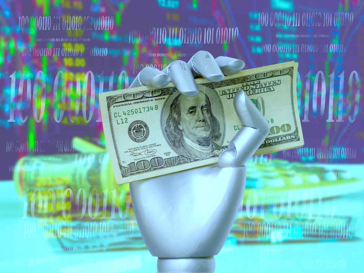 robo hand holding money | Robo Advisor For Automated Investing: What Is It, and Is It Worth It? | Inside Your IRA | tax-loss harvesting