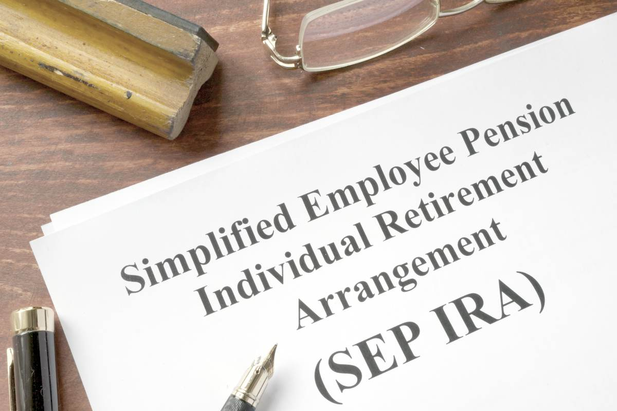 SEP IRA written on paper | SEP IRA Rules | Everything You Need To Know | traditional ira
