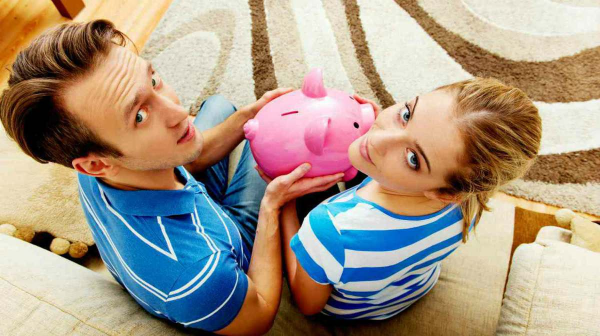 couple holding pink piggy bank | How Does A Roth IRA Work? | Roth IRA Resources | Inside Your IRA