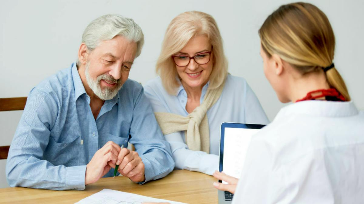 elderly couple talking with financial advisor | How Does A Roth IRA Work? | Roth IRA Resources | Inside Your IRA