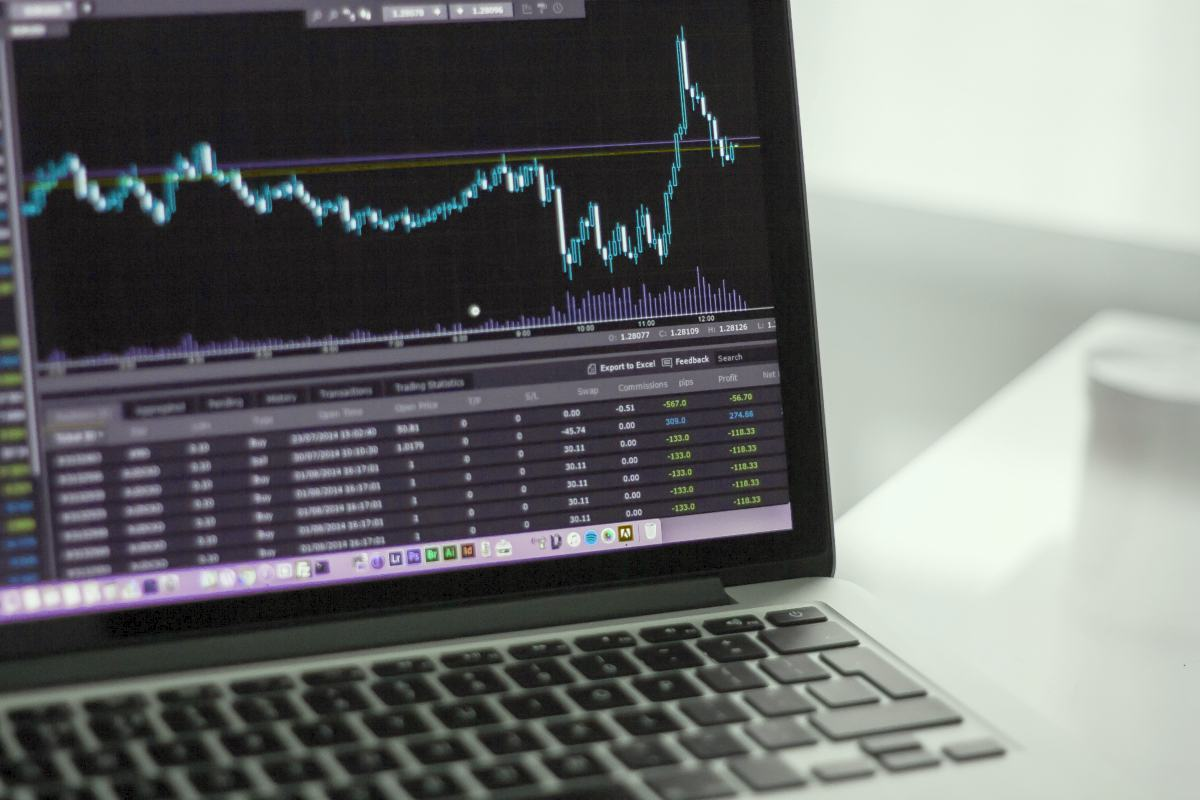 stocks on laptop screen | Alternative Investments You May Consider | Inside Your IRA | different types of investments