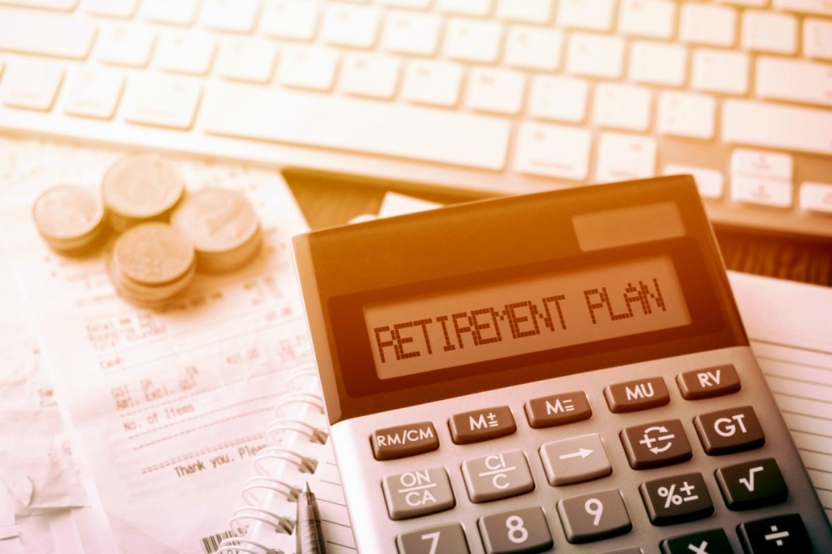 Retirement calculator with coins and receipts | Goal Monthly Budget For Standard Retirement | Inside Your IRA | budget for retirement
