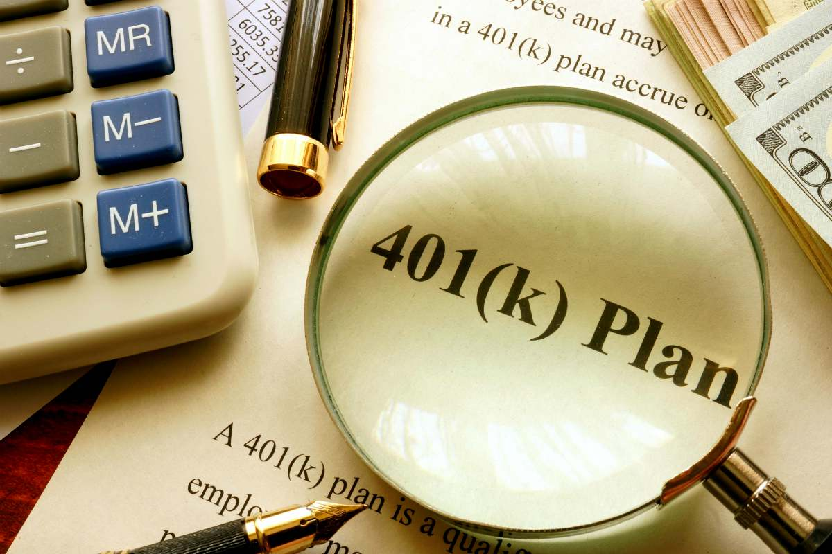 401k document under a magnifying glass | What Is A 401(k) vs Roth IRA? | Benefits Of Both Inside Your IRA | roth ira
