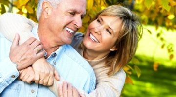 Feature   happy couple hugging outdoor   How To Live A Long Happy Retirement   Inside Your IRA   retirees