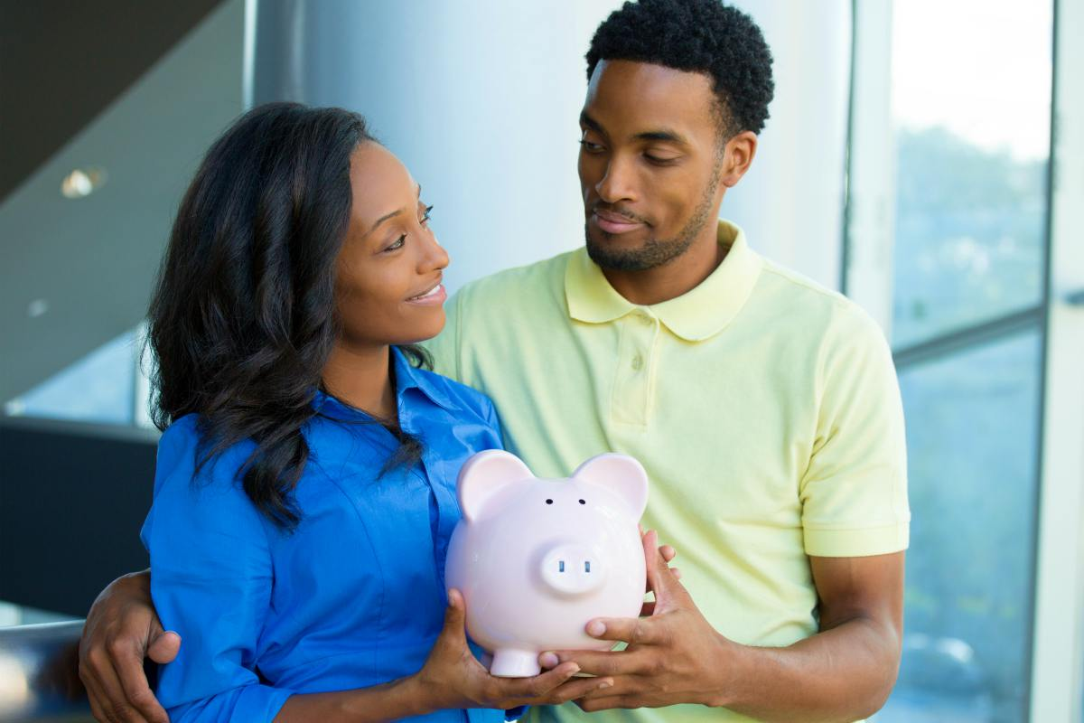 Couple holding a piggy bank together | How Does A Roth IRA Work? | Roth IRA Resources | Inside Your IRA