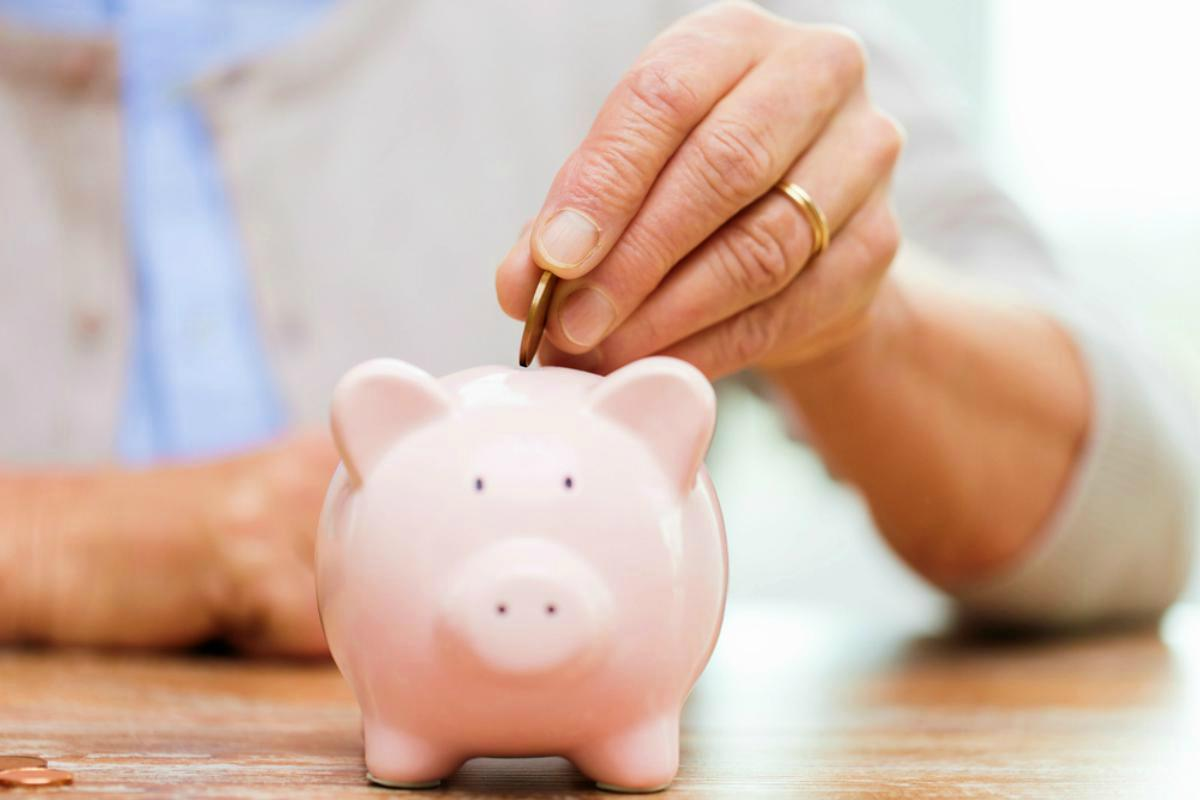 saving in a piggy bank | How To Retire At 50 | Inside Your IRA | how much do I need to retire