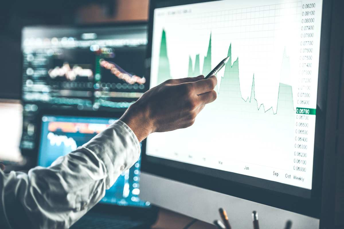 analyzing data closeup young businessman | Diversified Investment Portfolio Industry Exposure | Guide To A Diversified Portfolio | Inside Your IRA