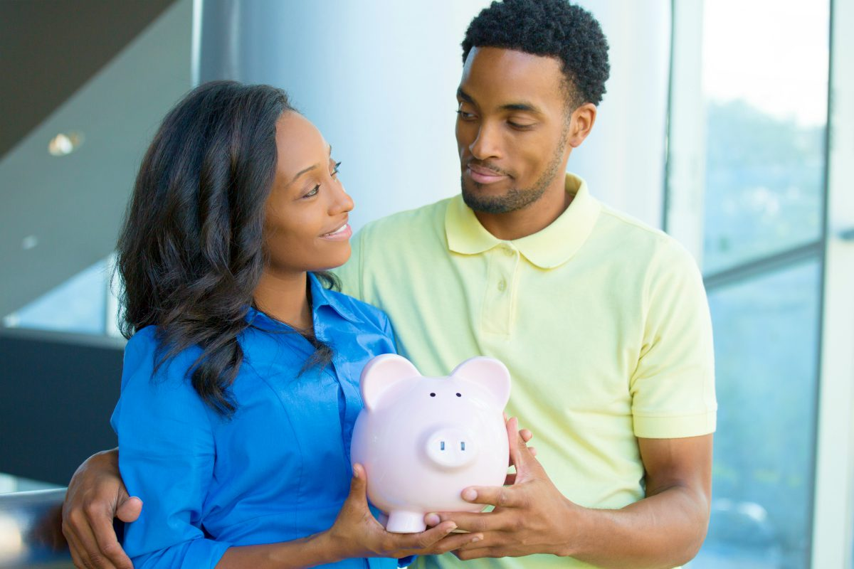 couple holding piggy bank | Types of IRAs | A Savings Comparison Inside Your IRA | required minimum distribution
