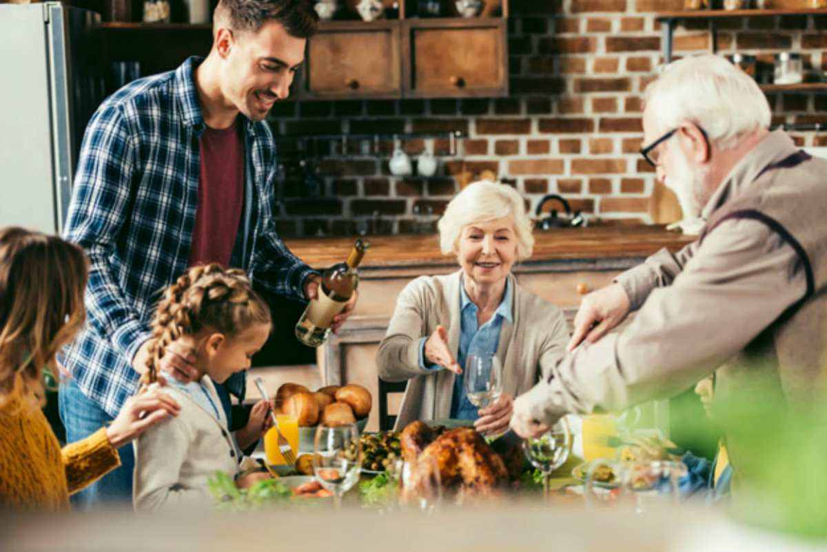 family having holiday dinner together   Great Retirement Ideas   Things To Do When You Retire   Inside Your IRA