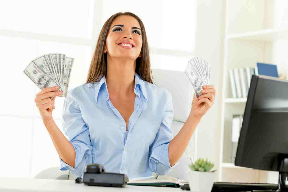 woman holding money on both hands | Roth IRA Rules You Most Likely Didn't Know Inside Your IRA
