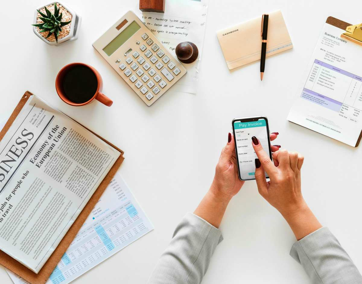 Person holding phone   Best Retirement Investments   Inside Your IRA