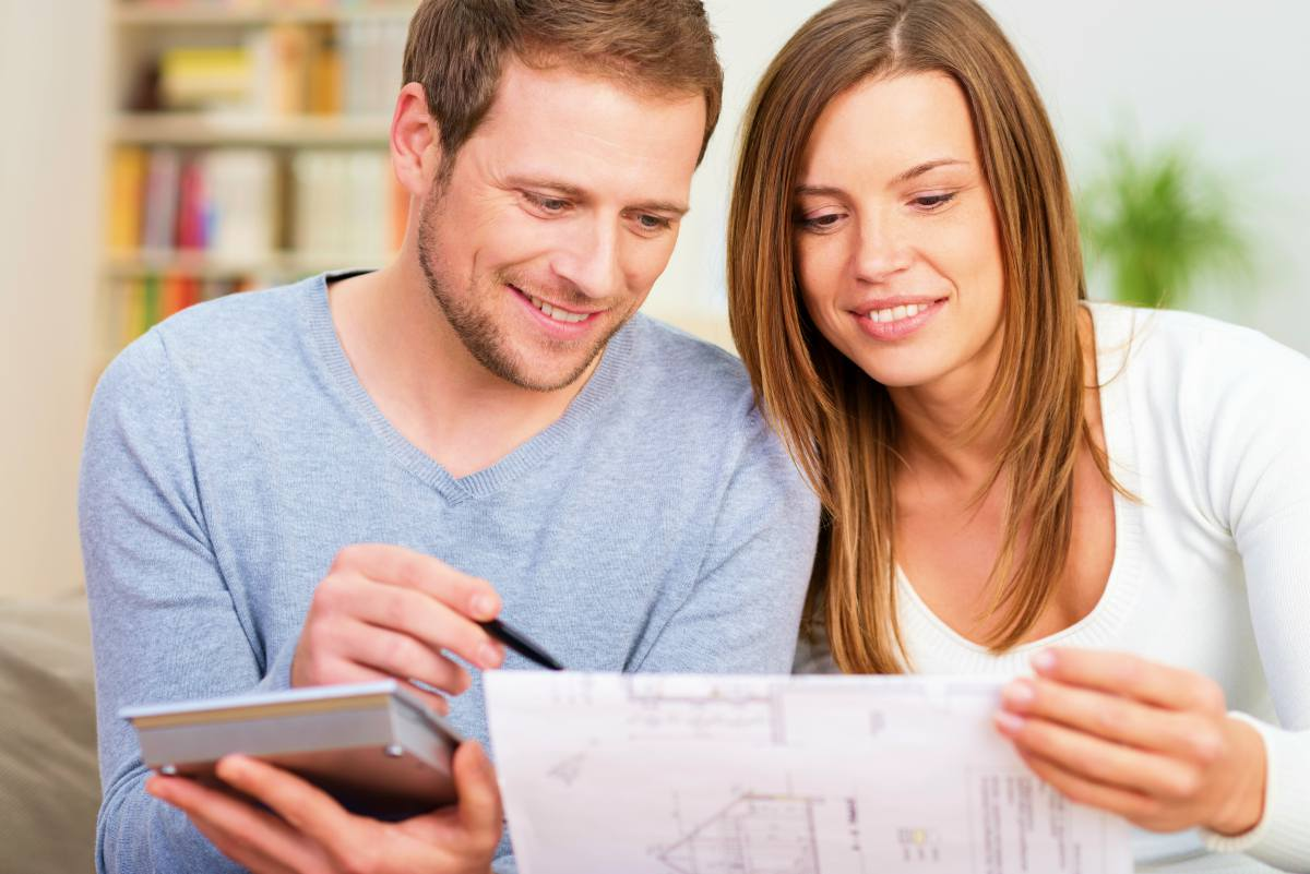 young couple planning new purchase sitting | Investing In Trust Deeds And Real Estate Inside Your IRA | mortgage