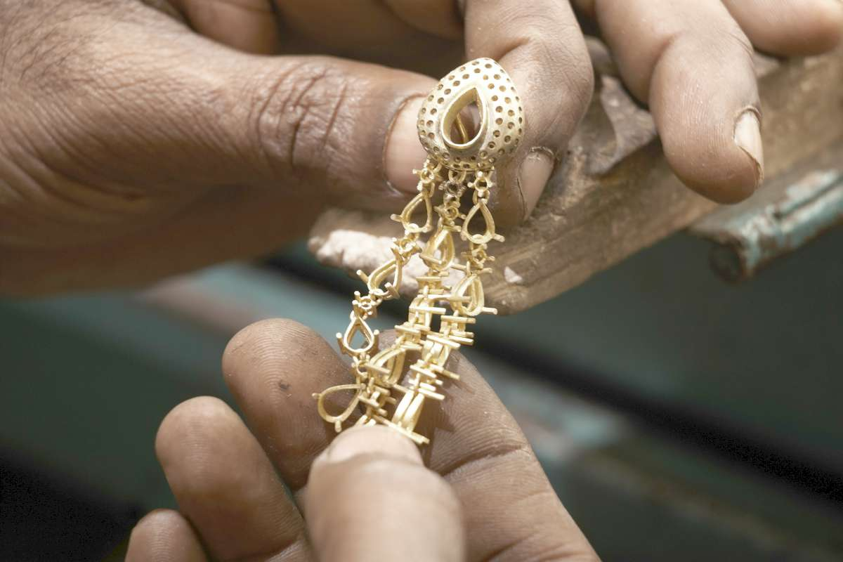 goldsmith holding unfinished 22 carat gold | Investments Not Allowed Inside A Self-Directed IRA | ira investments