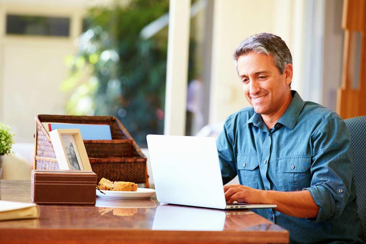 mature hispanic man using laptop | Retirement Readiness Checklist | Be Financially Ready To Retire | Inside Your IRA | Retirement