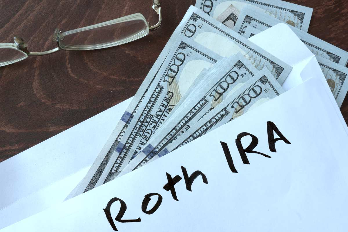 roth ira written on envelope dollars | Decide When to Apply for Social Security | Preparing for retirement