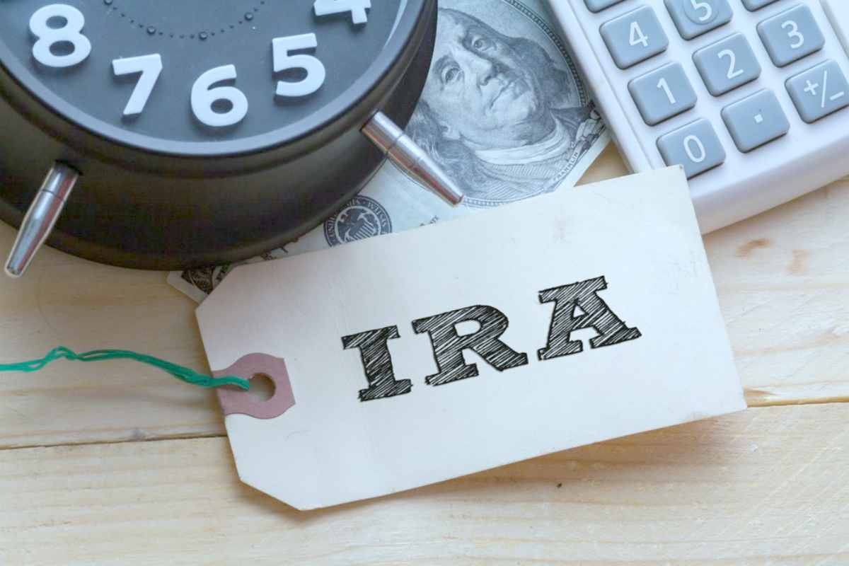 flatlay image with IRA written on a tag | Top Retirement Investments | Inside Your IRA | inside your ira