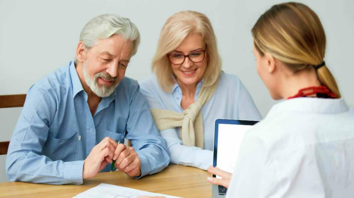 senior elderly couple listening to an advisor | Top Retirement Investments | Inside Your IRA | inside your ira