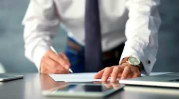 Feature   businessman signing documents   Self-Directed IRA Rules And Regulations   self directed ira rules