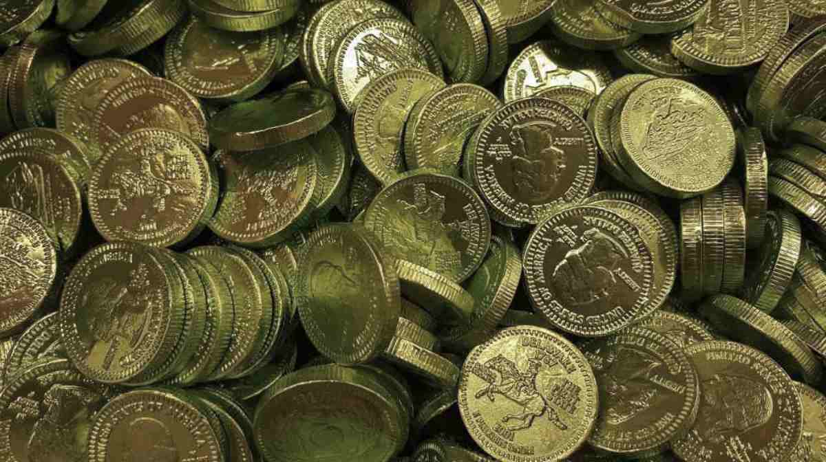 top view of gold coins | Top Retirement Investments | Inside Your IRA | retirement