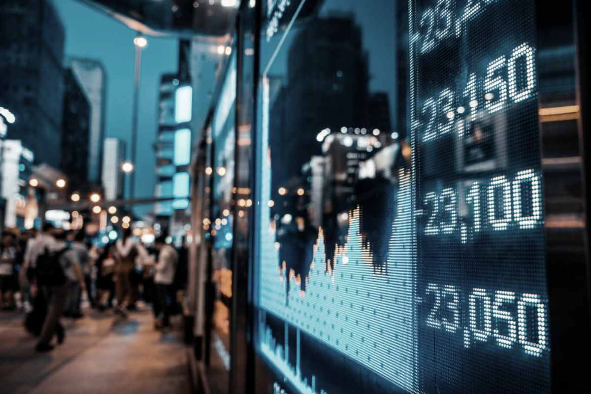 stocks screen on the busy street | Top Retirement Investments | Inside Your IRA | retirement