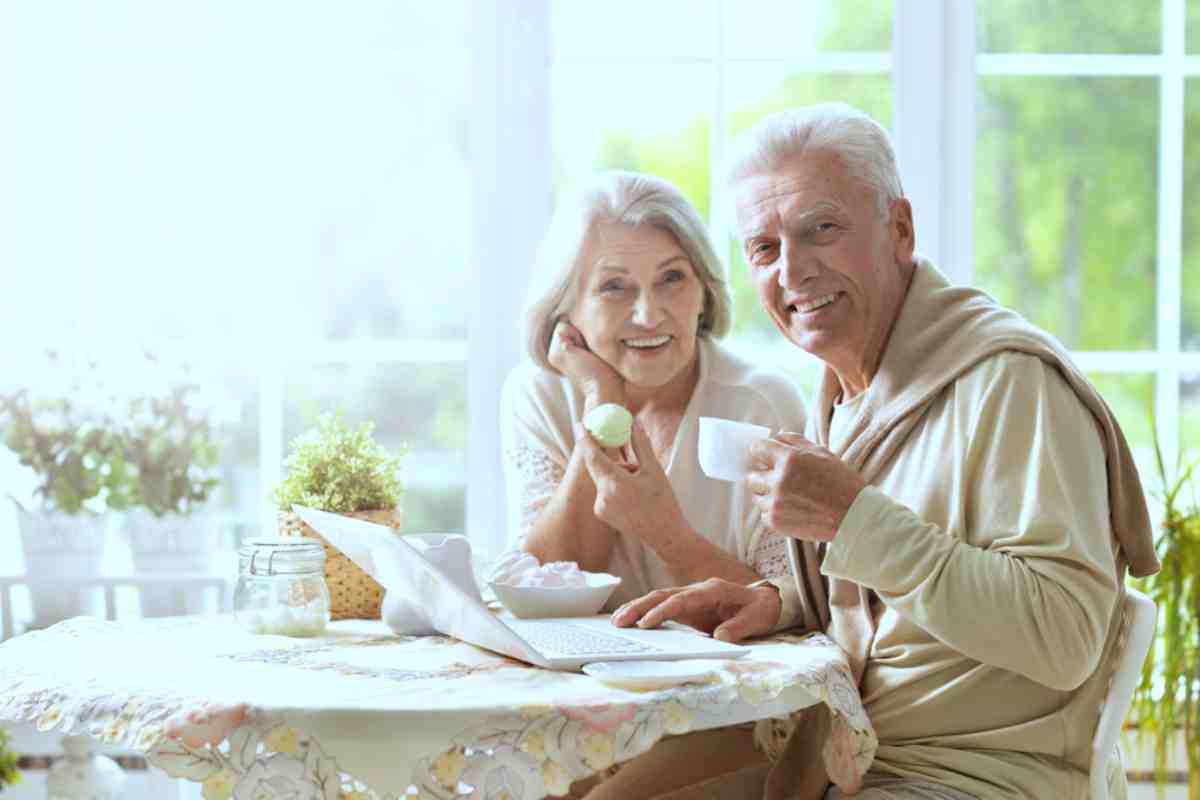 retired elderly couple smiling while having a morning snack | Top Retirement Investments | Inside Your IRA | inside your ira