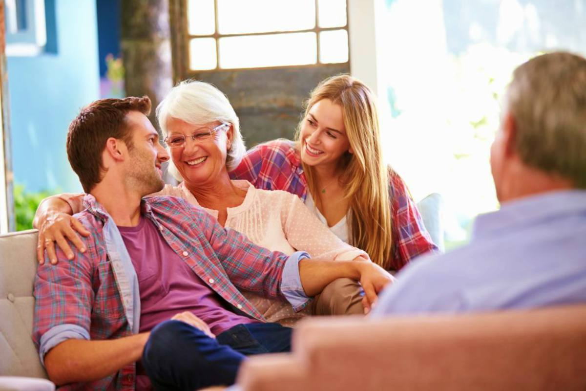 family relaxing on sofa | How To Designate Your IRA Beneficiary | Inside Your IRA | primary beneficiary dies