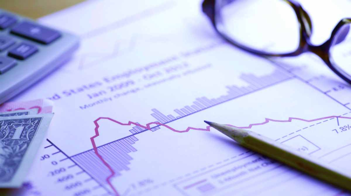paper with line and bar graph pencil calculator money and glasses | Top Retirement Investments | Inside Your IRA | retirement