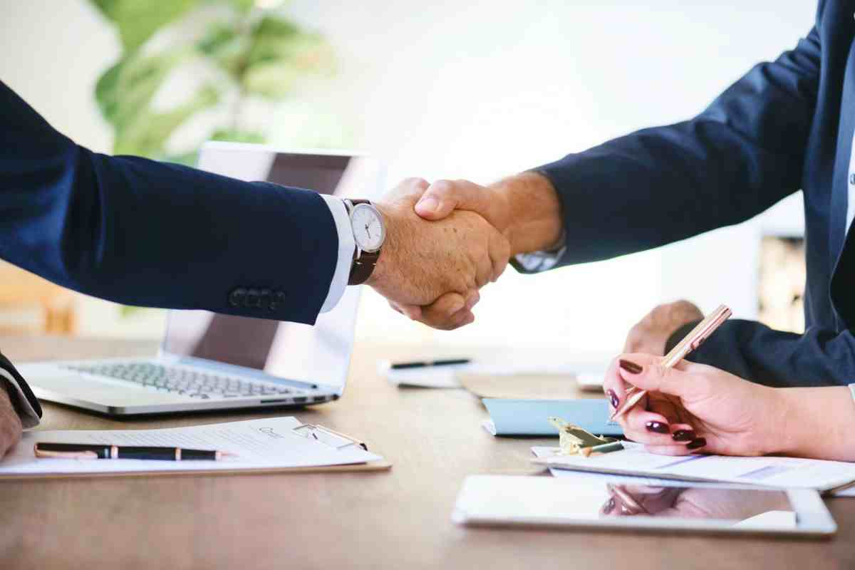 businessmen shakes hand | Top Retirement Investments | Inside Your IRA | ira