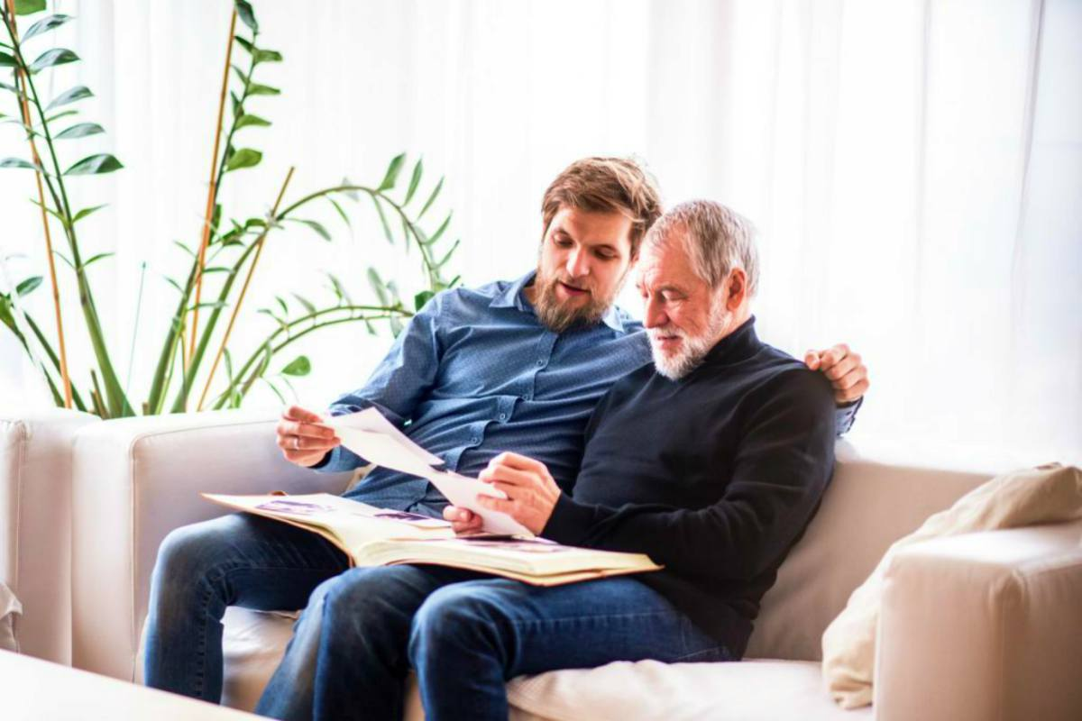 father and son holding papers | How To Designate Your IRA Beneficiary | Inside Your IRA | primary beneficiary