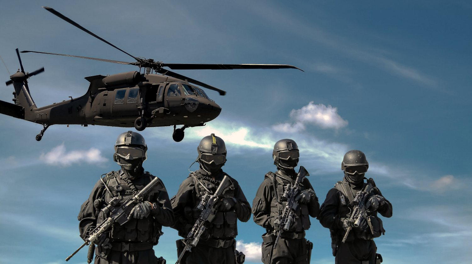 Featured | soldiers in front of a helicopter | Reasons To Invest In Defense Stocks Inside Your IRA | defense aerospace