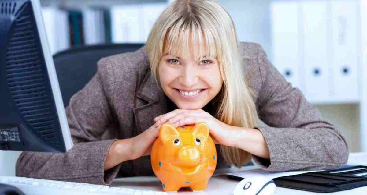 woman with piggy bank in office | Top Retirement Investments | Inside Your IRA | retirement